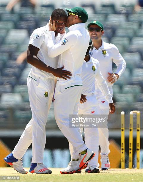 Kagiso Rabada of South Africa is kissed by Faf du Plessis of South Africa after claming his fifth wicket the wicket of Mitchell Starc of Australia...