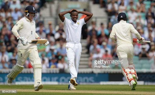 Kagiso Rabada of South Africa reacts as Tom Westley and Joe Root of England run during the fourth day of the 3rd Investec Test match between England...