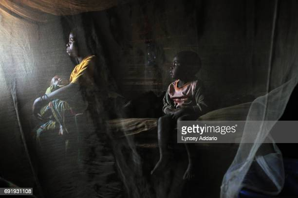Kahindo sits in her home with her two children born out of rape in the village of Kayna North Kivu in Eastern Congo April 12 2008 Kahindo was...