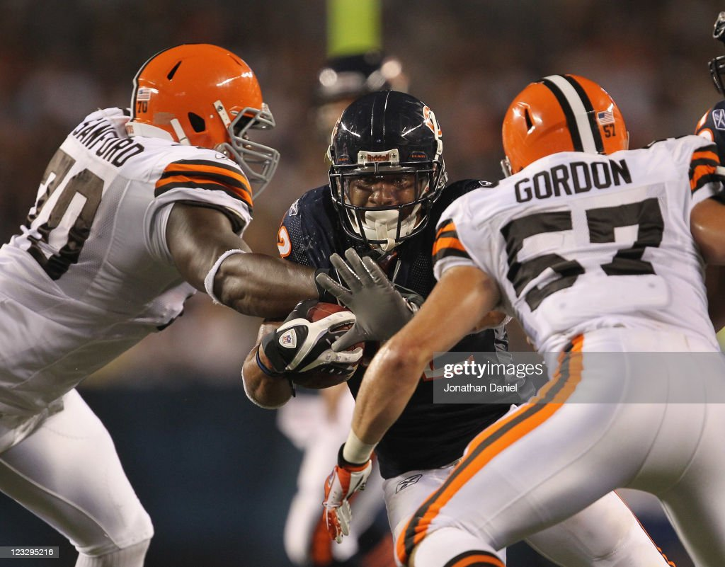 <a gi-track='captionPersonalityLinkClicked' href=/galleries/search?phrase=Kahlil+Bell&family=editorial&specificpeople=2085865 ng-click='$event.stopPropagation()'>Kahlil Bell</a> #32 of the Chicago Bears runs against Brian Sanford #70 and <a gi-track='captionPersonalityLinkClicked' href=/galleries/search?phrase=Eric+Gordon&family=editorial&specificpeople=4212733 ng-click='$event.stopPropagation()'>Eric Gordon</a> #57 of the Cleveland Browns during a preseason game at Soldier Field on September 1, 2011 in Chicago, Illinois.
