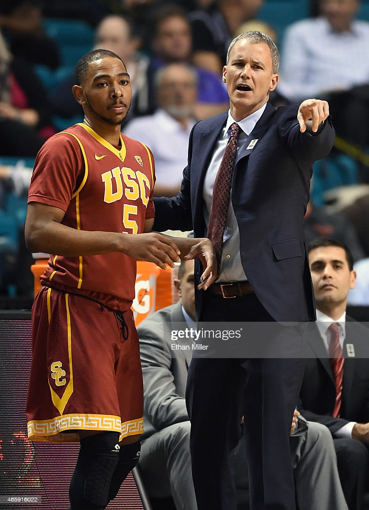 Kahlil Dukes #5 of the USC Trojans talks to head coach <a gi-track='captionPersonalityLinkClicked' href=/galleries/search?phrase=Andy+Enfield&family=editorial&specificpeople=5624033 ng-click='$event.stopPropagation()'>Andy Enfield</a> during a first-round game of the Pac-12 Basketball Tournament against the Arizona State Sun Devils at the MGM Grand Garden Arena on March 11, 2015 in Las Vegas, Nevada. USC won 67-64.