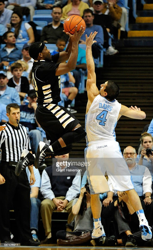 Kahlil Felder #20 of the Oakland Golden Grizzlies shoots over Luke Davis #4 of the North Carolina Tar Heels during play at the Dean Smith Center on November 8, 2013 in Chapel Hill, North Carolina. North Carolina won 84-61.