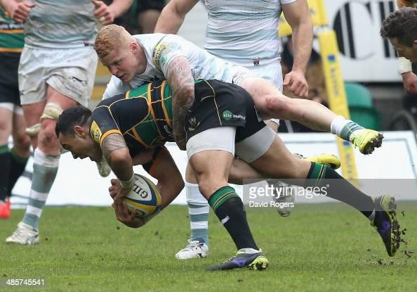 Kahn Fotuali'i of Northampton is tackled by Tom Homerduring the Aviva Premiership match between Northampton Saints and London Irish at Franklin's...