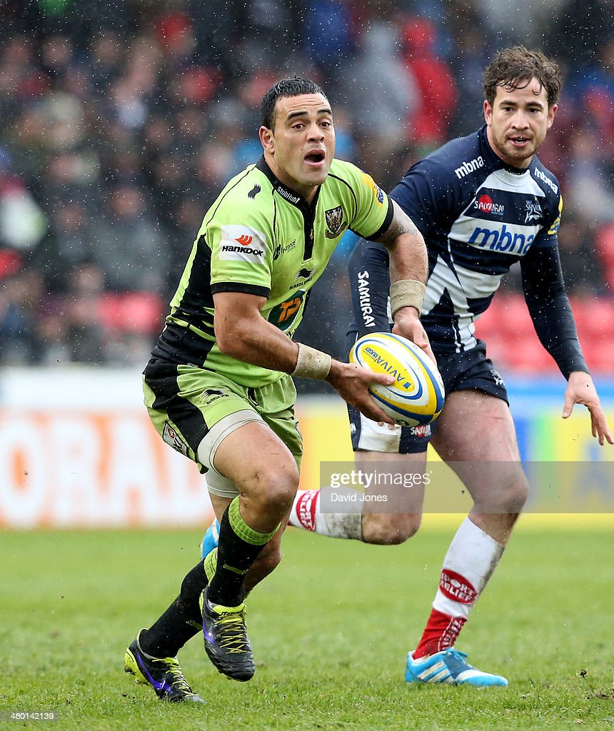 Kahn Fotuali'i of Northampton Saints with the ball and Danny Cipriani of Sale Sharks during the Aviva Premiership match between Sale Sharks and Northampton Saints at A J Bell Stadium on March 22, 2014 in Salford, England
