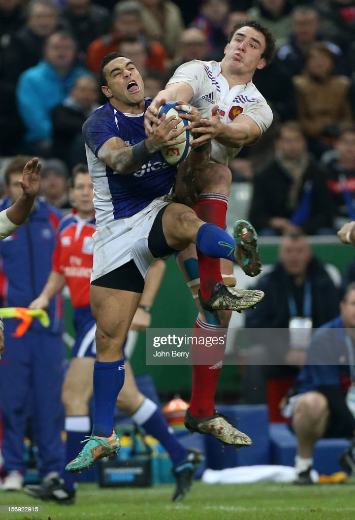 Kahn Fotuali'i of Samoa and Louis Picamoles of France in action during the Rugby Autumn International between France and Samoa at the Stade de France on November 24, 2012 in Paris, France.