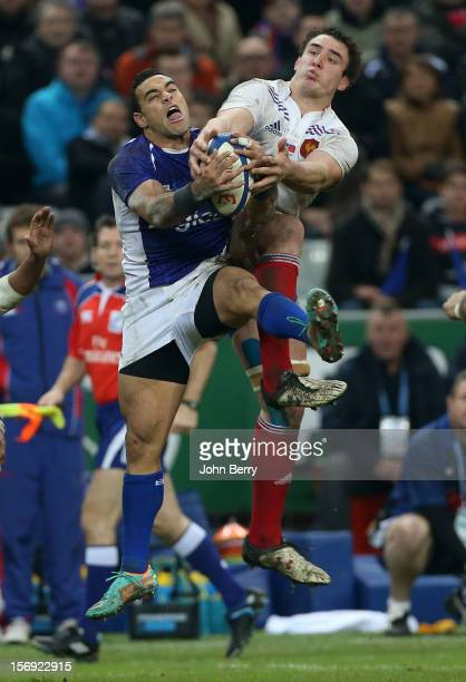 Kahn Fotuali'i of Samoa and Louis Picamoles of France in action during the Rugby Autumn International between France and Samoa at the Stade de France...