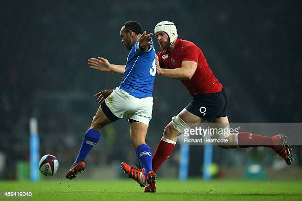 Kahn Fotuali'i of Samoa clears the ball downfield as Dave Attwood of England closes in during the QBE international match between England and Samoa...