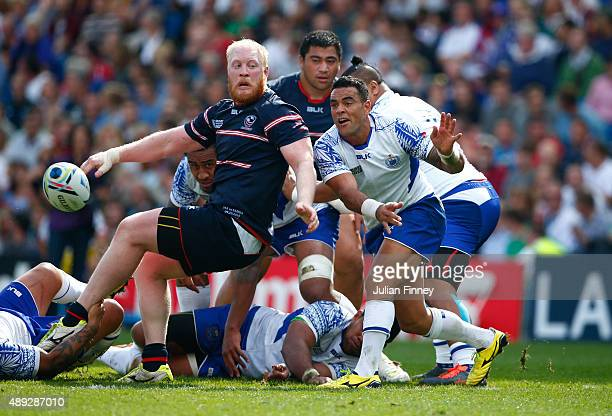 Kahn Fotuali'i of Samoa is tackled by Eric Fry of the United States as he passes during the 2015 Rugby World Cup Pool B match between Samoa and USA...