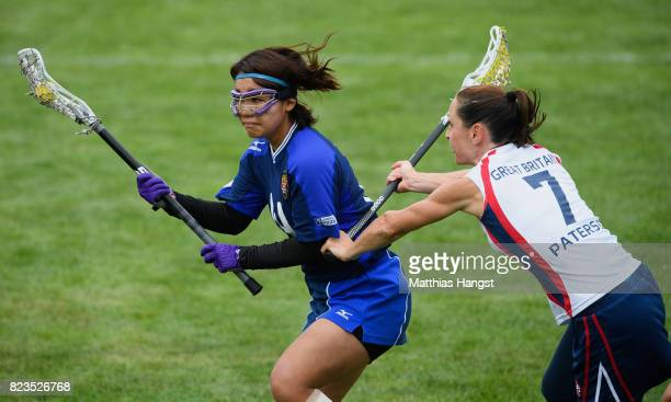 Kaho Inoue of Japan is challenged by Julia Paterson of Great Britain during the Lacrosse Women's match between Great Britain and Japan of The World...