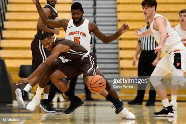 Kahron Ross of the Lehigh Mountain Hawks loses a handle on the ball while being guarded by Amir Bell of the Princeton Tigers during the first half at...