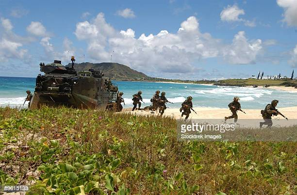 Kahuku Training Area Oahu, Hawaii, July 18, 2004 - U.S. Marines run out of an Amphibious Assault Vehicle during a mechanized raid in support of exercise Rim of the Pacific (RIMPAC) 2004.
