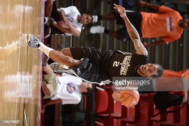 Kahwi Leonard of the San Antonio Spurs dribbles versus the Los Angeles Lakers during NBA Summer League on July 17 2012 at the Thomas Mack Center in...
