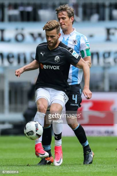 Kai Buelow of 1860 Munich and Lucas Hoeler of Sandhausen battle for the ball during the Second Bundesliga match between TSV 1860 Muenchen and SV...