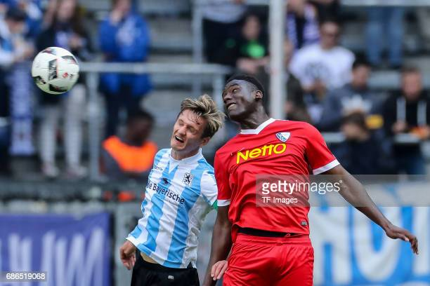 Kai Buelow of 1860 Munich und Peniel Kokou Mlapa of Bochum battle for the ball during the Second Bundesliga match between TSV 1860 Muenchen and VfL...