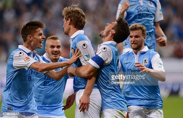 Kai Buelow of Muenchen celebrates his team's second goal with team mates during the 2 Bundesliga playoff second leg match between 1860 Muenchen and...