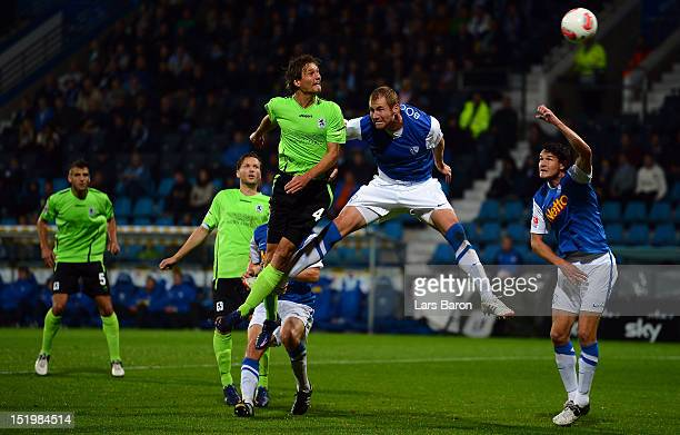 Kai Buelow of Muenchen goes up for a header with Lukas Sinkiewicz of Bochum during the Second Bundesliga match betweeen VfL Bochum and 1860 Muenchen...