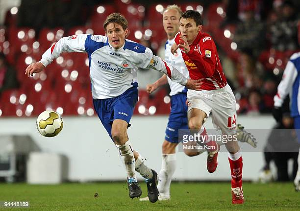Kai Buelow of Rostock battles for the ball with Sergiu Radu of Cottbus during the Second Bundesliga match between FC Energie Cottbus and FC Hansa...