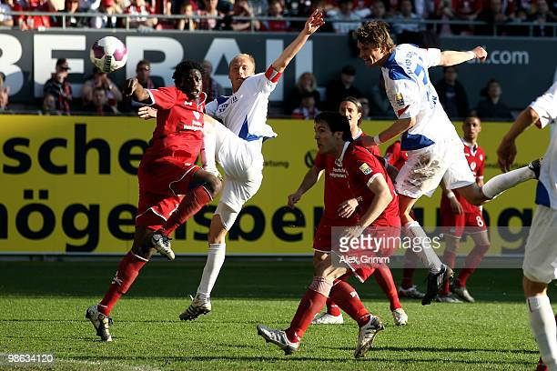 Kai Buelow of Rostock scores his team's first goal against Srdjan Lakic and Rodnei of Kaiserslautern during the Second Bundesliga match between 1 FC...