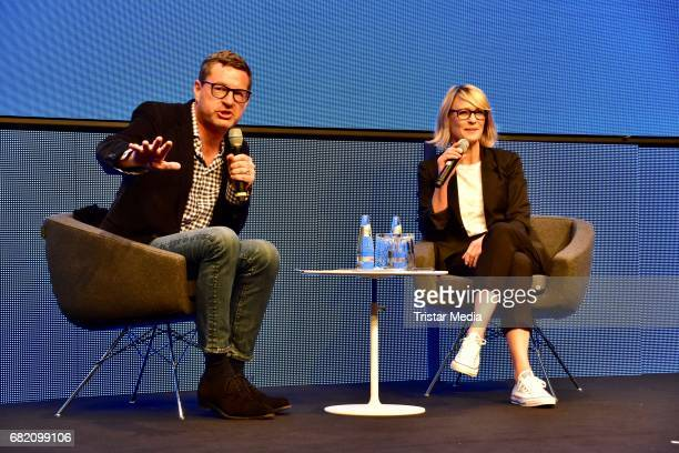 Kai Diekmann and Robin Wright during the Opening Cube Tech Fair at City Cube on May 11 2017 in Berlin Germany