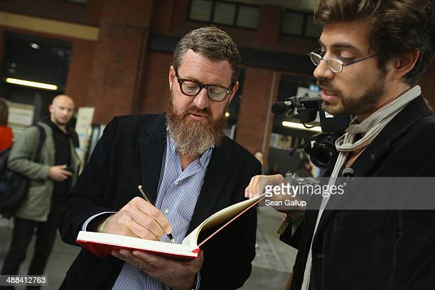 Kai Diekmann chief editor of Bild tabloid signs a petition at the 2014 republica conferences on digital society on May 6 2014 in Berlin Germany The...