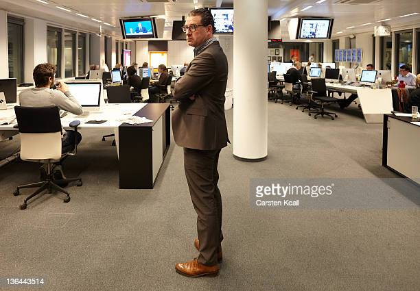 Kai Diekmann EditorinChief of the German tabloid Bild stands in the newsroom at the office of newspaper Bild on December 12 2010 in Berlin Germany