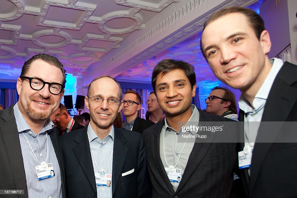 Kai Diekmann (L), Luc Frieden, Luxembourg's finance minister, Aditya Mittal (2ndR) , chief financial officer of ArcelorMittal and DLD Founder Marcel Reichart (R) attend the Burda DLD Nightcap 2011 at the Steigenberger Belvedere hotel on January 25, 2012 in Davos, Switzerland. DLD (Digital - Life - Design) is a global conference network on innovation, digital, science and culture which connects business, creative and social leaders, opinion-form science and culture which connects business, creative and social leaders, opinion-formers and investors for crossover conversation and inspiration.