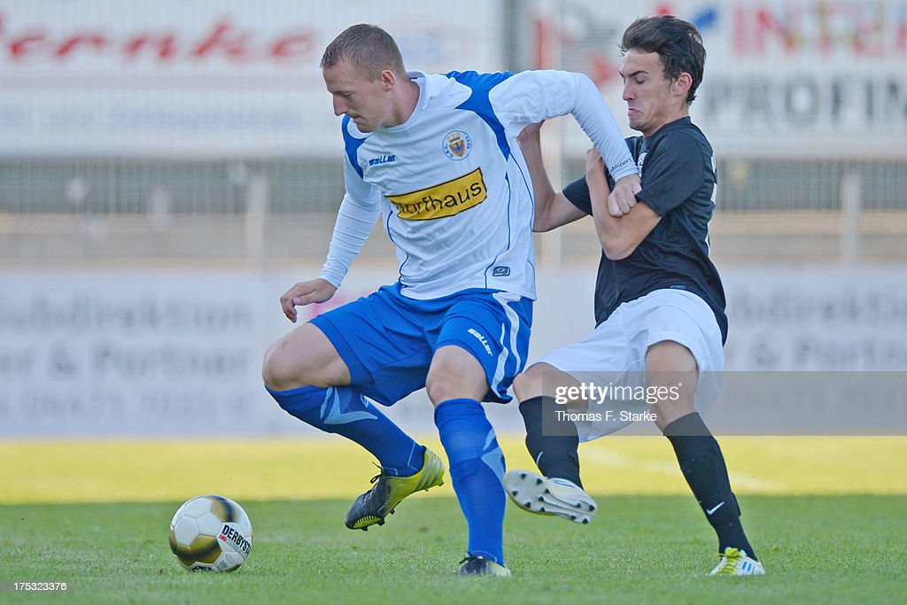 Kai - Fabian Schulz (L) of Goslar and Julian Bennert of Cloppenburg fight for the ball during the Regionalliga North match between BV Cloppenburg and Goslarer SC at stadium Cloppenburg on August 2, 2013 in Cloppenburg, Germany.