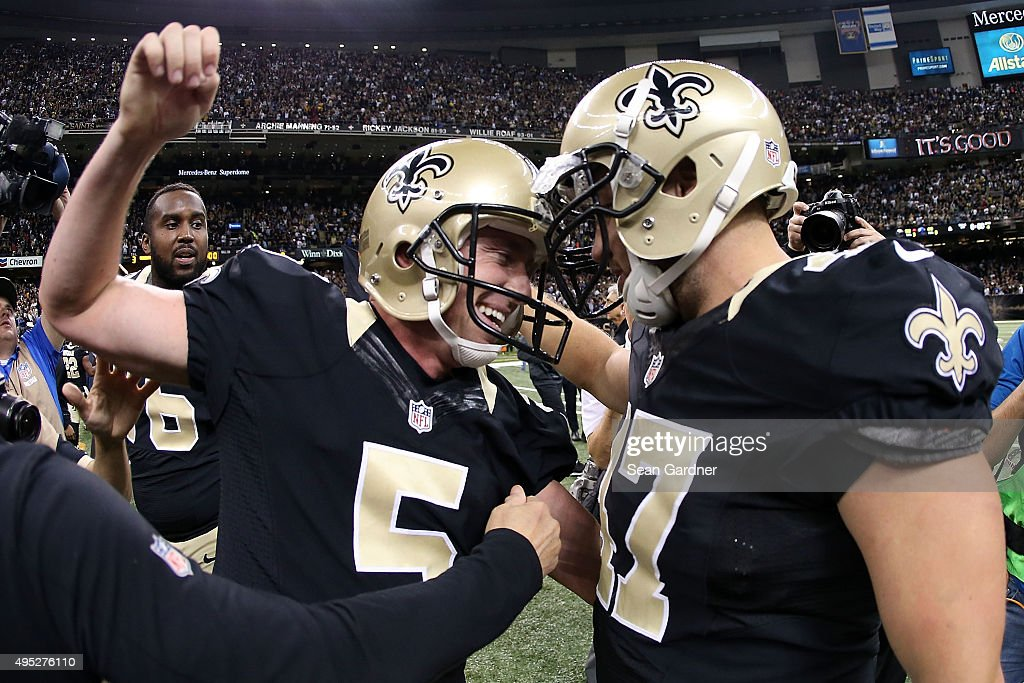 Kai Forbath #5 of the New Orleans Saints celebrates with Justin Drescher #47 following a game winning field goal against the New York Giants at the Mercedes-Benz Superdome on November 1, 2015 in New Orleans, Louisiana.