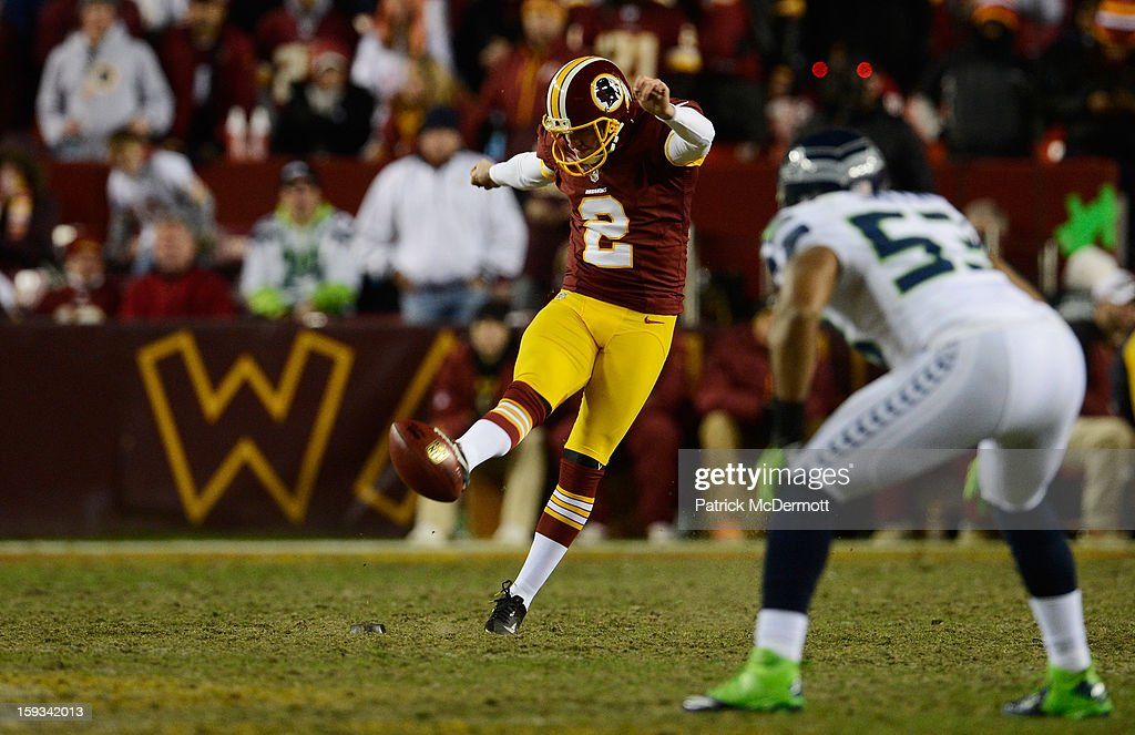 Kai Forbath #2 of the Washington Redskins punts the ball against the Seattle Seahawks during the NFC Wild Card Playoff Game at FedExField on January 6, 2013 in Landover, Maryland.