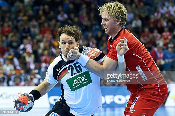 Kai Hafner of Germany fights for the ball with Erlend Mamelund of Norway during the Men's EHF Handball European Championship 2016 match between...