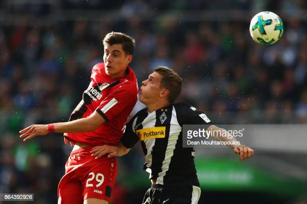 Kai Havertz of Bayer 04 Leverkusen battles for the ball with Matthias Ginter of Borussia Monchengladbach during the Bundesliga match between Borussia...
