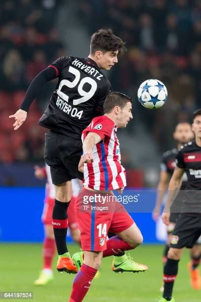 Kai Havertz of Bayer Leverkusen and Gabi of Atletico Madrid battle for the ball during the UEFA Champions League Round of 16 first leg match between...