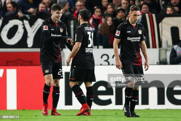 Kai Havertz of Bayer Leverkusen celebrates with Kevin Volland after scoring his team's first goal to make it 01 during the Bundesliga match between...