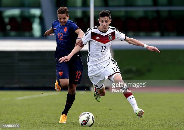 Kai Havertz of Germany challenges Justin Lonwijk of Netherlands during the U16 UEFA development tournament between Germany and Netherlands on...