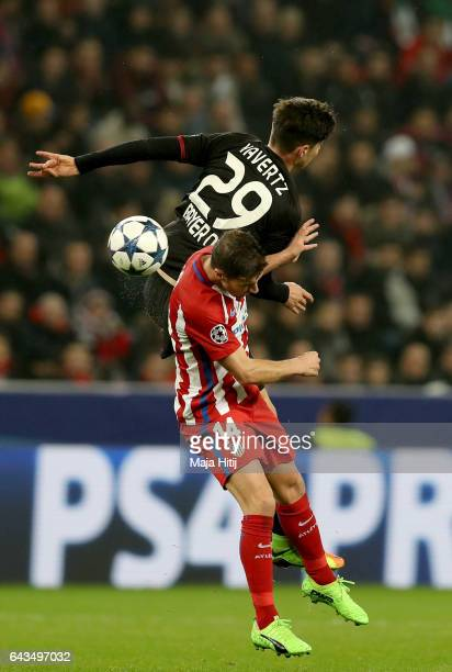 Kai Havertz of Leverkusen and Gabi of Atletico battle for the ball during the UEFA Champions League Round of 16 first leg match between Bayer...