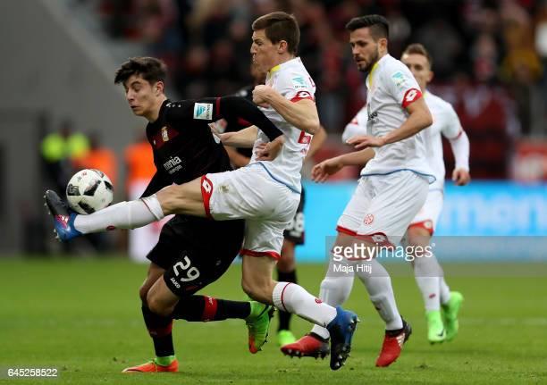 Kai Havertz of Leverkusen and Gaetan Bussmann of Mainz battle for the ball during the Bundesliga match between Bayer 04 Leverkusen and 1 FSV Mainz 05...