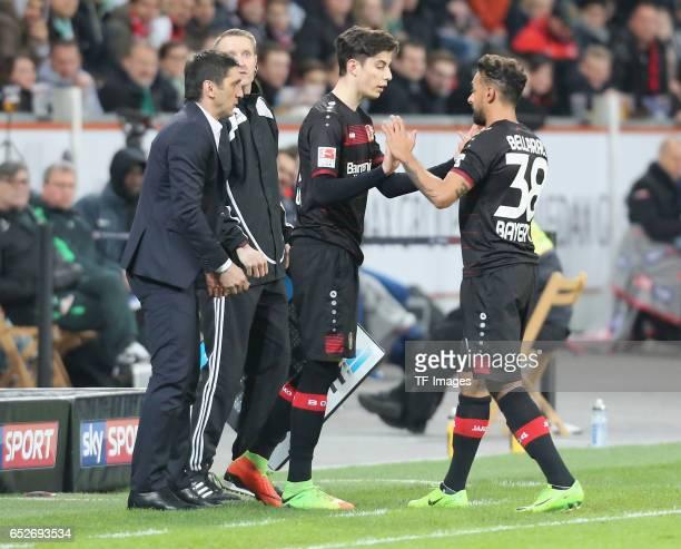 Kai Havertz of Leverkusen shakes hands with Karim Bellarabi during the Bundesliga soccer match between Bayer Leverkusen and Werder Bremen at the...