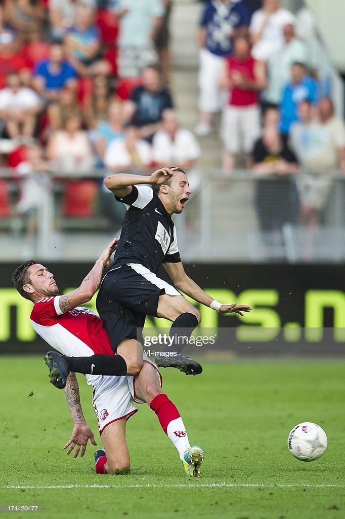 Kai Heerings of FC Utrecht, Omar er Rafik of FC Differdange 03 during the Europa League second qualifying round match between FC Utrecht and FC Differdange on July 25, 2013 in Utrecht, The Netherlands.