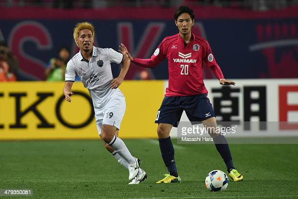 Kai Hirano of Buriram United and Kenyu Sugimoto of Cerezo Osaka compete for the ball during the AFC Champions League match between Cerezo Osaka and...