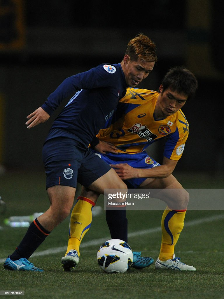 Kai Hirano #19 of Buriram United (L) and Kodai Watanabe #3 of Vegalta Sendai compete for the ball during the AFC Champions League Group E match between Vegalta Sendai and Buriram United at Sendai Stadium on February 26, 2013 in Sendai, Japan.