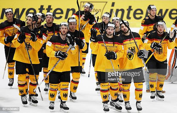 Kai Hospelt and team Germany thank the fans after losing the Germany v Canada Deutschland Cup 2016 Ice Hockey match at Curt Frenzel Stadion on...