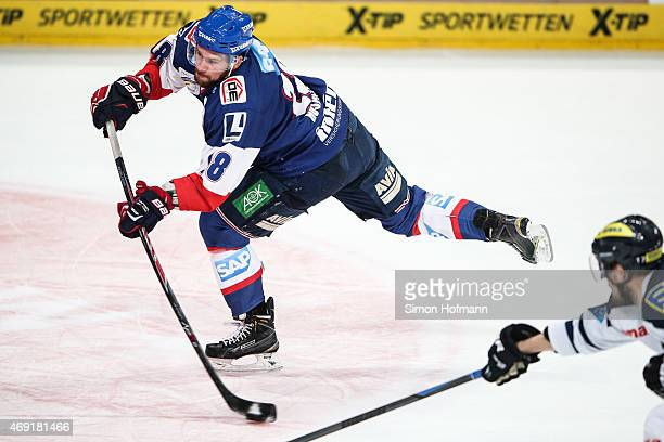 Kai Hospelt of Mannheim tries to score during the DEL Playoffs Final Game 1 between Adler Mannheim and ERC Ingolstadt at SAP Arena on April 10 2015...