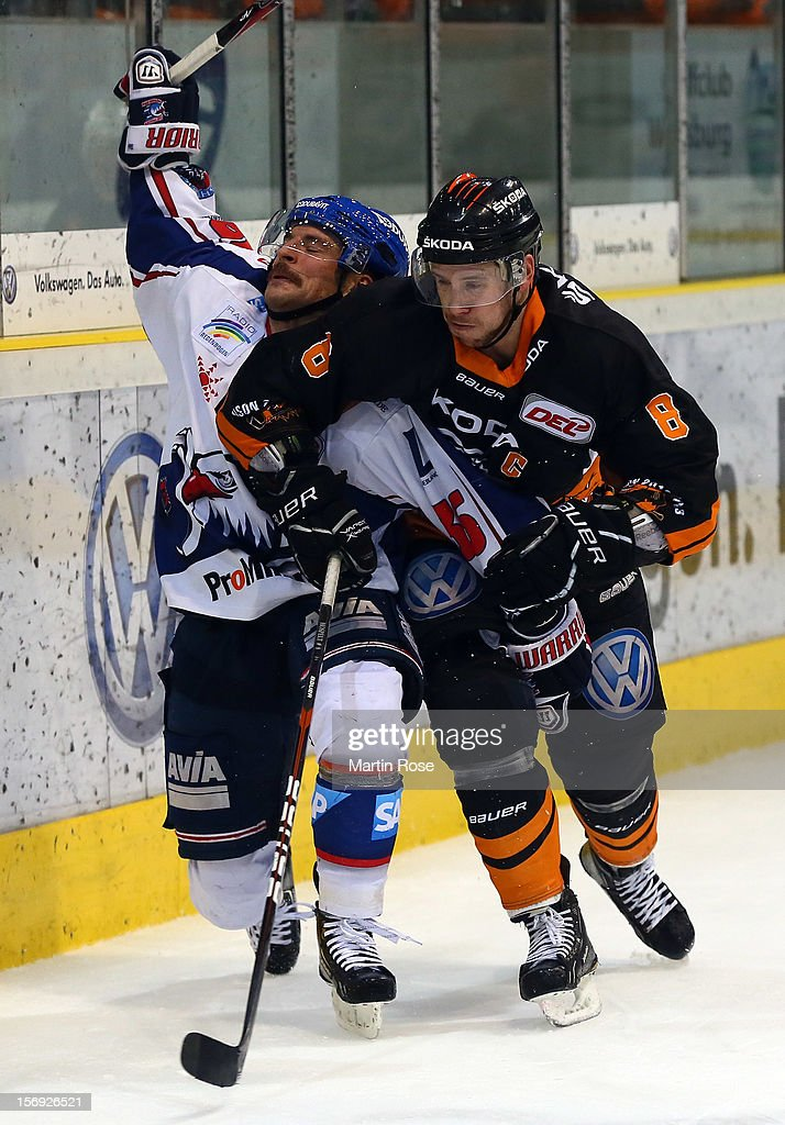 Kai Hospelt (R) of Wolfsburg battles for the puck with <a gi-track='captionPersonalityLinkClicked' href=/galleries/search?phrase=Yannic+Seidenberg&family=editorial&specificpeople=670576 ng-click='$event.stopPropagation()'>Yannic Seidenberg</a> (L) of Mannheim during the DEL match between Wolfsburg Grizzly Adams and Adler Mannheim at Volksbank BraWo EisArena on November 25, 2012 in Wolfsburg, Germany.