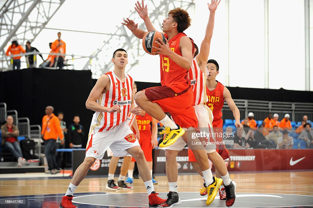 Kai Jiang #12 of Team China drives to the basket during the Nike International Junior Tournament game between Team China Vs Crvena Zvezda Telekom Belgrade at Soccerdome on May 9, 2013 in London, United Kingdom.