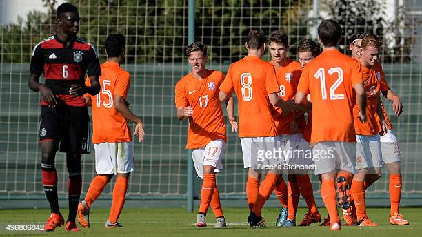 Kai Koreniuk of Netherlands celebrates with team mates after scoring the opening goal from a penalty during the U18 four nations friendly tournament...
