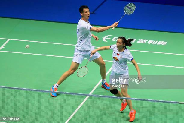 Kai of China hits a return next to him partner Huang Yaqiong during their mixed doubles semifinal match against LEE Chun Hei Reginald and CHAU Hoi...