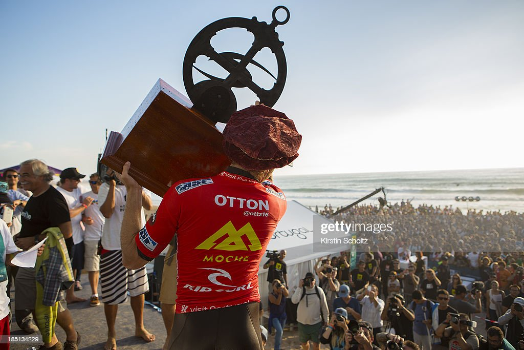 Kai Otton of Australia lifts his winners trophy for the crowd on October 17, 2013 in Peniche, Portugal.