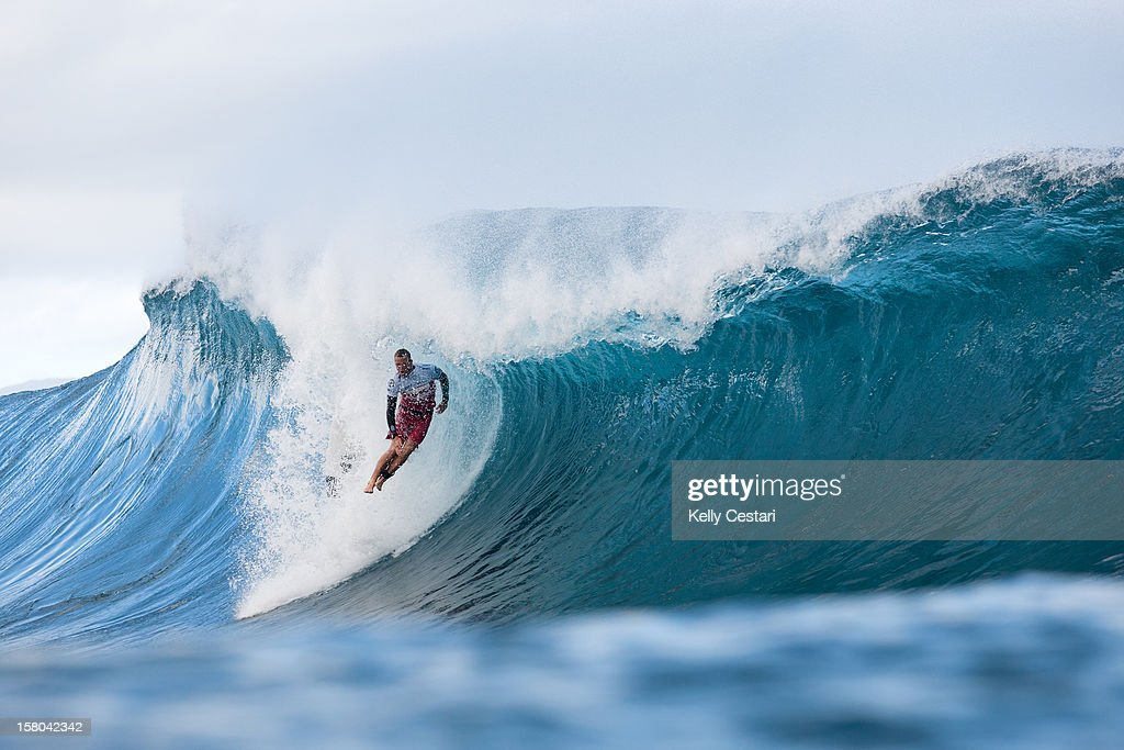 Kai Otton of Australia pin drops from the top of a wave during Round 3 of the Billabong Pipe Masters on December 9, 2012 in North Shore, Hawaii.