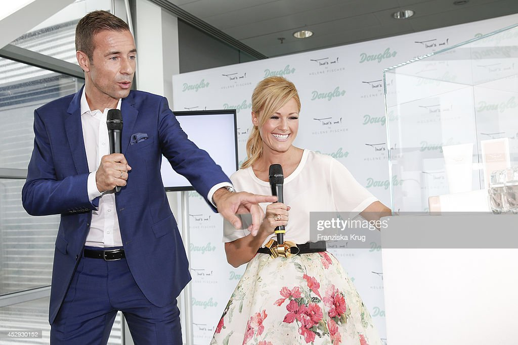 Kai Pflaume and Helene Fischer attend the Douglas And Helene Fischer Launch Fragrance 'That's Me' on July 30 2014 in Munich Germany