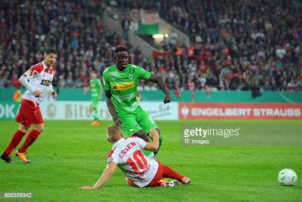 Kai Pröger of Essen and Denis Zakaria of Gladbach battle for the ball during the DFB Cup match between Rot Weiss Essen and Borussia Moenchengladbach...